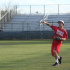 Sam Mahofski, 12, warms up his throw before practice.