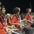 Members of the drum line, including sophomore Anthony Peterson, perform on the sidelines at a home football game.
