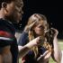 Senior Meghan Qualls tapes up Dorian Fords fingers at Legacy vs. Summit varsity game