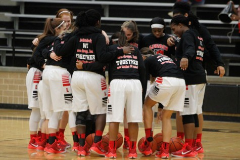 Girls' Varsity Basketball Wins First District Game