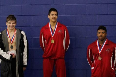 Swim Team Members Advance to Regionals