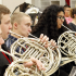 Band students rehearse for a winter concert before their fourth-annual golf tournament.