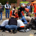 Caleb Jones, right, hold his arms above his head in disbelief after a speeding car killed four people at OSU's Sea of Orange parade. Jones graduated from Legacy in 2014. (David Bitton/ Stillwater News Press)