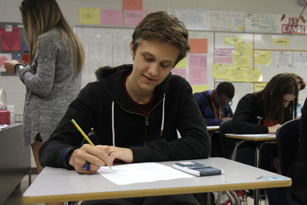 Antoine Briard, 11, works on a paper in class. Briard is a foreign exchange student from Paris, France.