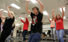 Jacqueline Lum, 12, and Logan Jenkins, 12 rehearse the choreography to the song You