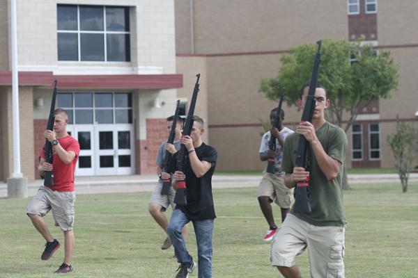 Senior Austin Bernal practices alongside his fellow cadets.