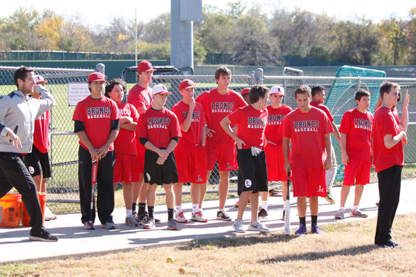 The baseball team gathers with new head coach, Chris McMullen, for a hitting drill.