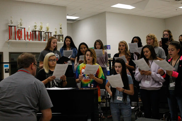 [File Photo] Choir prepares for competition by practicing during class.