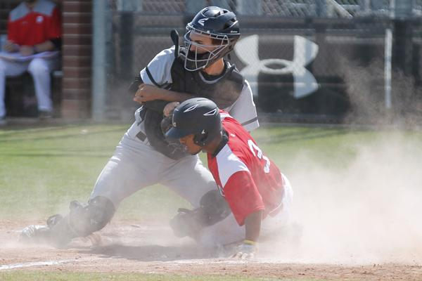 Cameron Fisher, 12, slides into a base. Varsity Baseball will face Red Oak on April 28.