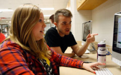 Grant Baker, 12, trains Kathryn Pedroza, 11, to be editor-in-chief of therideronline, the school