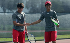 Tennis Moves to Round Two
