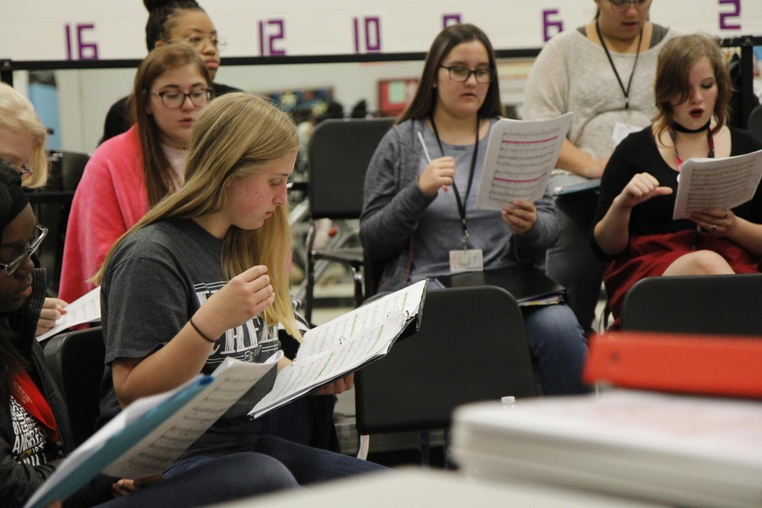 Freshman Blaire Bussey reads music during her choir class.