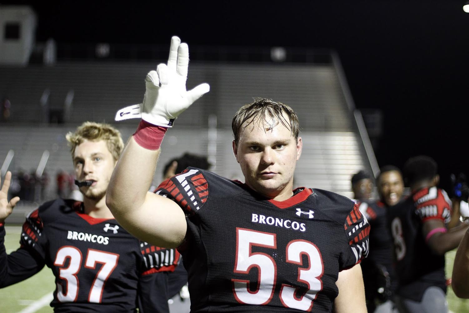 Senior Toby Griffin stands for the School Song at the ending of the game against Mansfield Timberview, the last game he played before finding out he could no longer participate in football.