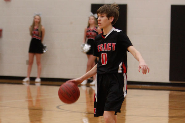 Eli Riley, 9, takes the ball down the court during the freshmen A basketball match against Lake Ridge on Jan. 12.