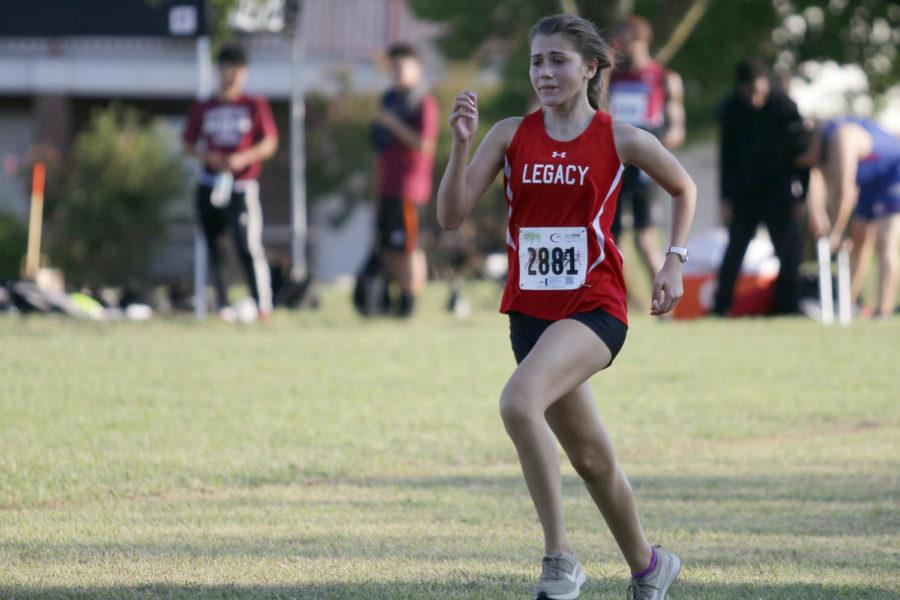 Hope+Richardson%2C+9%2C+runs+during+a+cross+country+meet.+Richardson+hopes+to+move+up+to+varsity.+