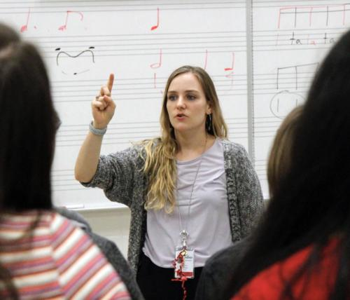 Ms. Lafferty teaches her 7th period Concert Choir class how to count triplet rhythms. The students are preparing for their upcoming fall concert in October. (Delayne Fierro photo)