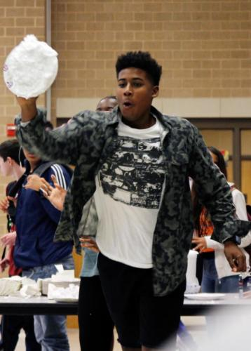 "Michael Cooper, 11, prepares to throw a plate of shaving cream at Coach Michael Keel during A lunch. Students were allowed to throw ""pie"" at teachers, students, and assistant principals for $1.00 during lunches to raise money for student council. (Kassidy Duncan photo)"