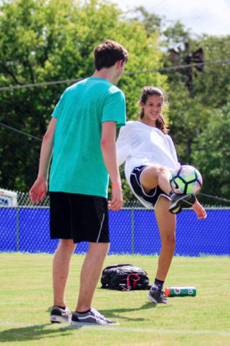 Isabelle Ryan, 11, juggles a soccer ball during the Project C.A.R.E field day event. Each student paid $10 to attend the field day to raise money for cancer charities. (Conner Riley photo)